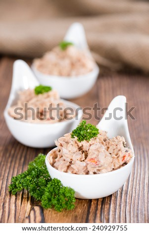 Fresh made Tuna Salad in a small bowl (on wooden background) - stock photo