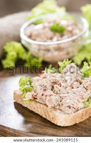 Fresh made Tuna salad sandwich on rustic wooden background - stock photo