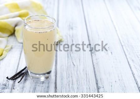 Fresh made Vanilla Shake on rustic wooden background - stock photo