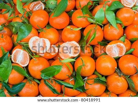 Fresh mandarin citrus fruits on a market stand - stock photo
