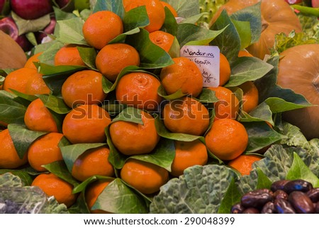 Fresh mandarin oranges at farmers fruits market. - stock photo
