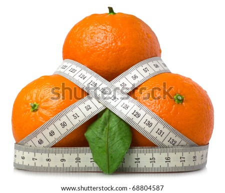 Fresh mandarins with tape measure isolated on white. - stock photo