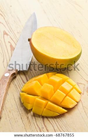 fresh mango fruit on wooden table - stock photo
