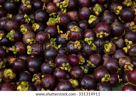 Fresh mangosteen for sale at an outdoor market. - stock photo