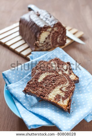 fresh marble cake sliced on a plate