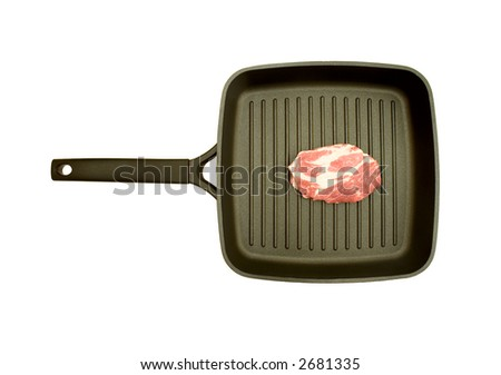 fresh meat on the frying pan, isolated against white background - stock photo