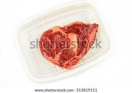 Fresh Meat on White Plastic Tray - stock photo