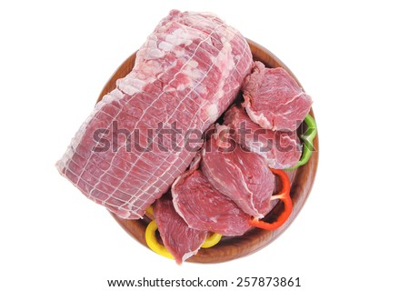 fresh meat on wood with sliced pepper - stock photo