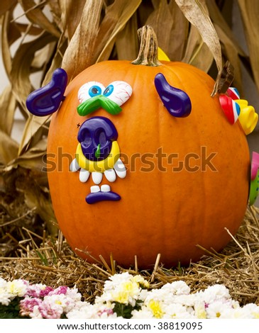 Fresh medium size pumpkin decorated with a face - stock photo