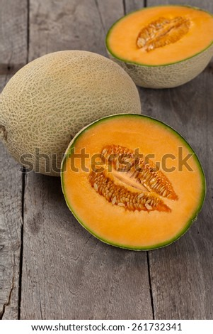 Fresh melons on old wooden background. Selective focus. - stock photo