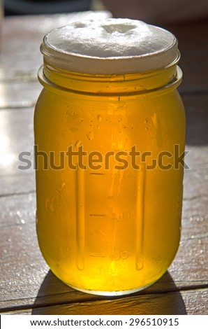 Fresh microbrew craft brew beer served in a glass pint canning jar - stock photo