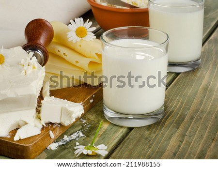 Fresh milk and dairy products on a wooden table. Selective focus - stock photo