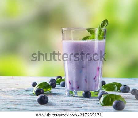 Fresh milk, blueberry  drink on wooden table, assorted protein cocktails with fresh fruits.   - stock photo