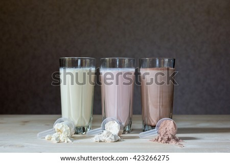 Fresh milk, chocolate, blueberry and banana drinks on table, assorted protein cocktails. - stock photo