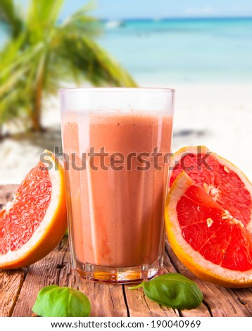 Fresh milk, grapefruit, drink isolated on white background with tropical beach, assorted protein cocktails, fruits. - stock photo