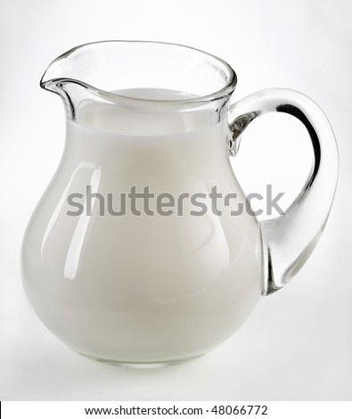 Fresh Milk in pitcher isolated on white background  - stock photo