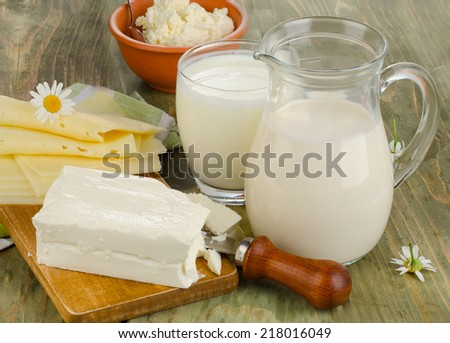 Fresh milk  products on  wooden table. Selective focus - stock photo