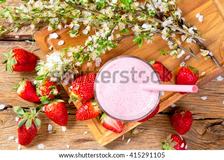 Fresh milk, strawberry,drink on wooden table, assorted protein cocktail with fresh fruits.  - stock photo