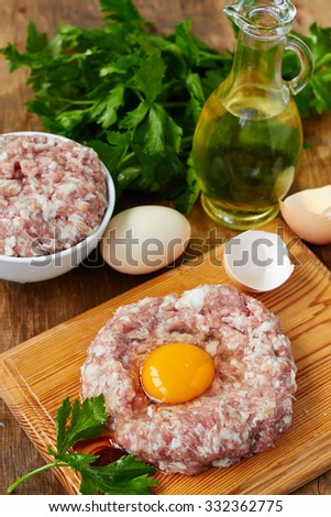 Fresh minced force meat with egg - stock photo