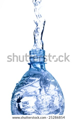 Fresh mineral water pouring from of a bottle