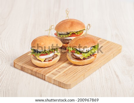 Fresh mini burger served meal on table - stock photo