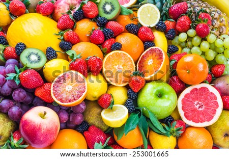 Fresh mixed fruits.Fruits background.Healthy eating, dieting.Love fruits, clean eating. - stock photo