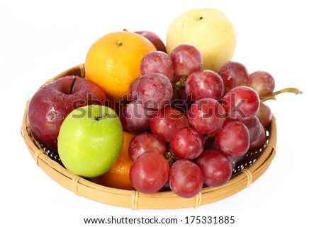 fresh mixed fruits on plate - stock photo