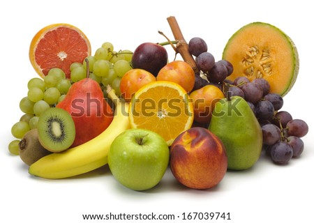 fresh mixed fruits on plate over white background - stock photo