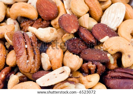 fresh mixed nuts and fruit for backgrounds - stock photo