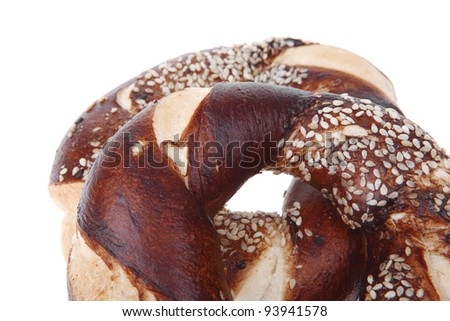 fresh mixed pretzels topped by sesame isolated over white background