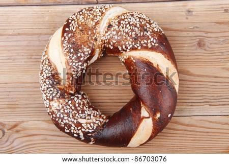 fresh mixed pretzels topped by sesame on wooden table