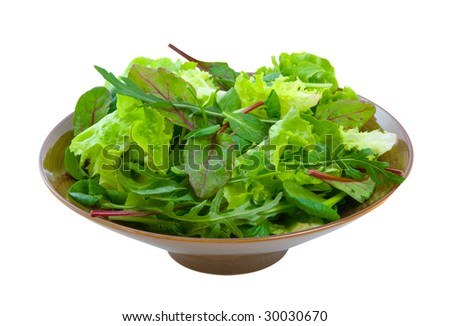 Fresh mixed salad greens in serving bowl isolated over white background.