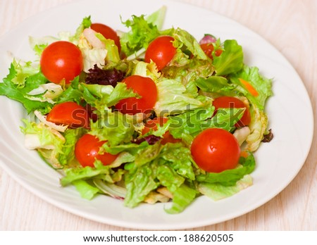 fresh mixed salad leaves with cherry tomatoes