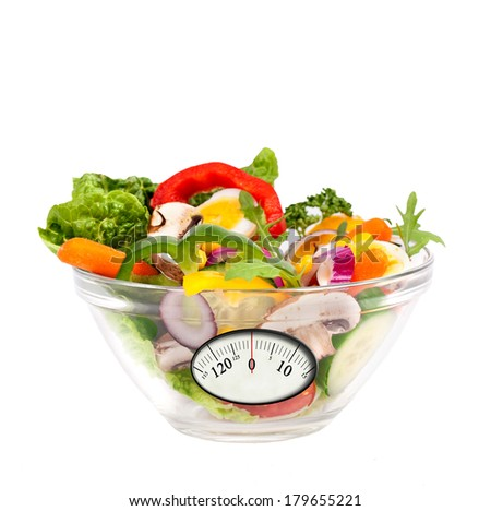 Fresh mixed salad with analogous weight scale. Diet concept  - stock photo
