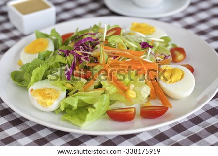 Fresh mixed salad with eggs, salad leaves and other vegetables