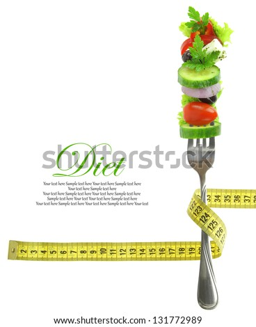 Fresh mixed vegetables on fork with measuring tape - stock photo