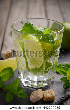 Fresh mojito cocktail with lime and mint, selective focus, copy space