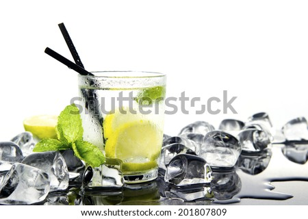 fresh Mojito cocktail with mint, lime, ice and soda - stock photo