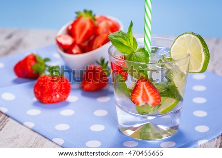 Fresh mojito cocktail with strawberries