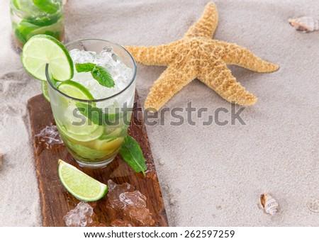 Fresh mojito drink on beach - stock photo