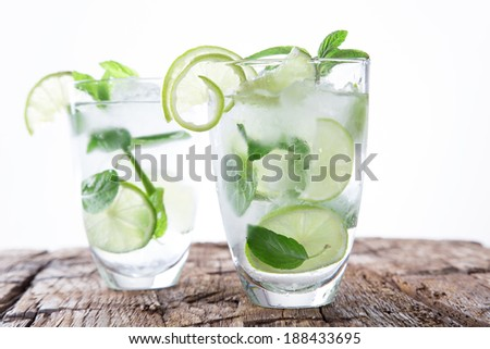 Fresh mojito drink on wooden table - stock photo