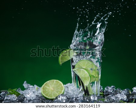 fresh mojito drink with liquid splash, freeze motion. - stock photo