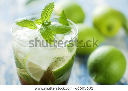 fresh mojito on a rustic table - stock photo
