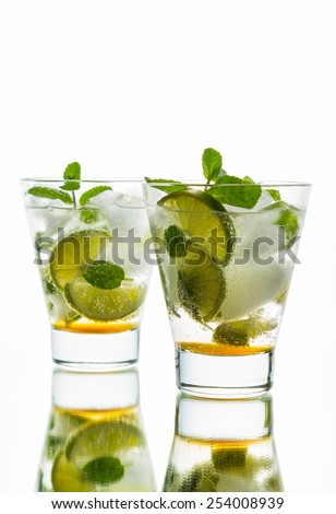 Fresh mojito on the wooden table - stock photo