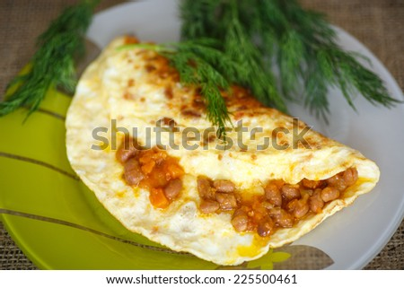 fresh morning egg omelet with beans and greens - stock photo