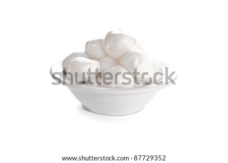 Fresh Mozzarella cheese in a white bowl isolated on white - stock photo