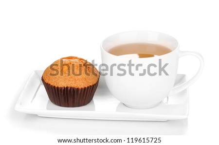 Fresh muffin with tea isolated on white