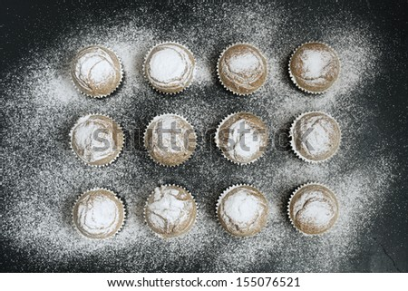 Fresh muffins with sugar icing. - stock photo