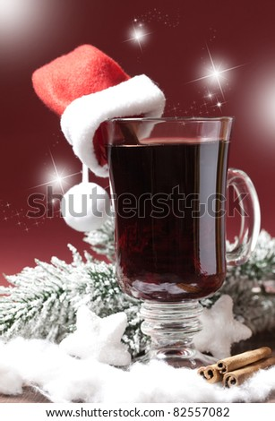 fresh mulled wine with christmas hat - stock photo
