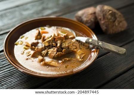 Fresh mushroom soup on wooden background close up - stock photo